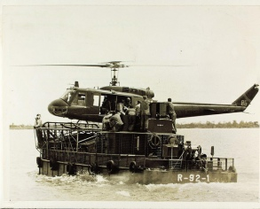 Helicopter landing aboard river boat Vietnam War. Photo Public Domain Courtesy of San Diego Air & Space Museum Archive.